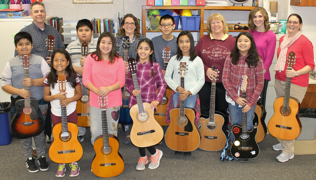 Mr. Newlon with Guitar Club Students